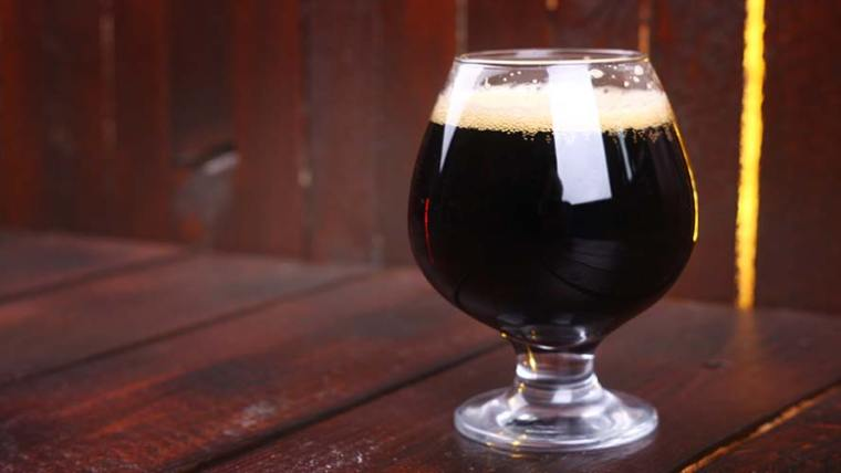 A glass of porter style beer.