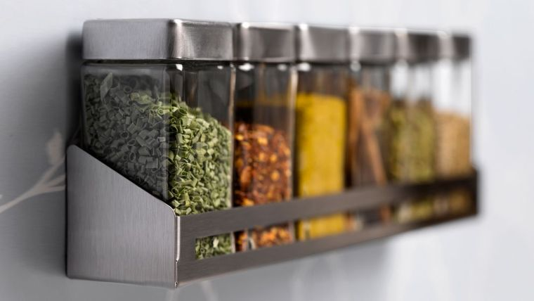 A shelf with storage containers.