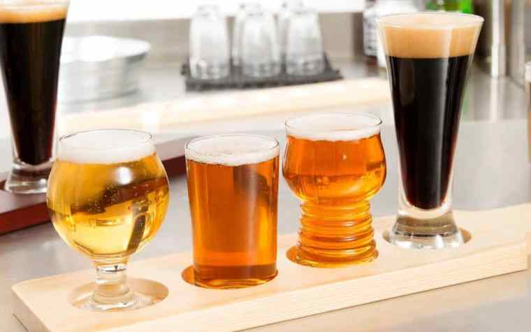 Different beer glasses filled with different types of beer styles.
