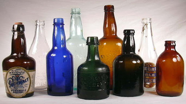 Various types sizes and colors of beer bottles