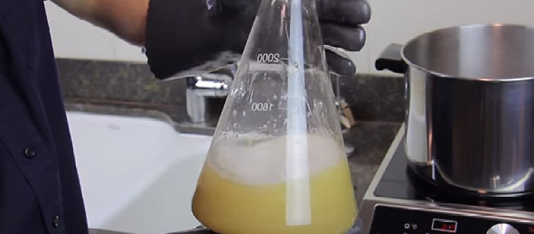 Boiling the yeast starter and using protective gloves to shake the flask.