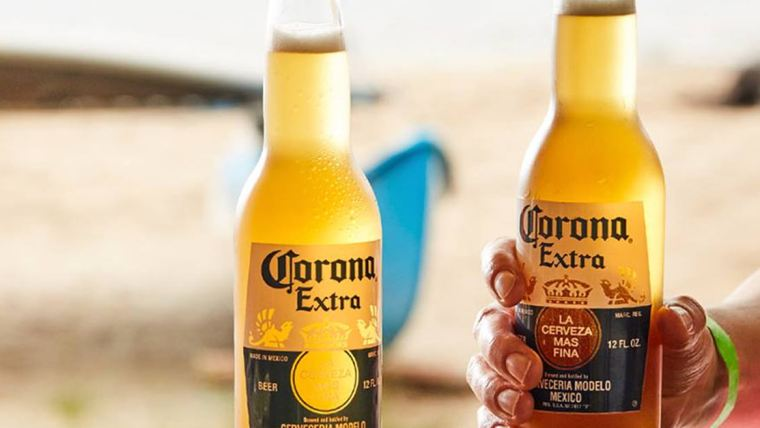 Two bottles of Corona Beer on a sunny beach.