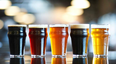 Five glasses of different color and beer styles.