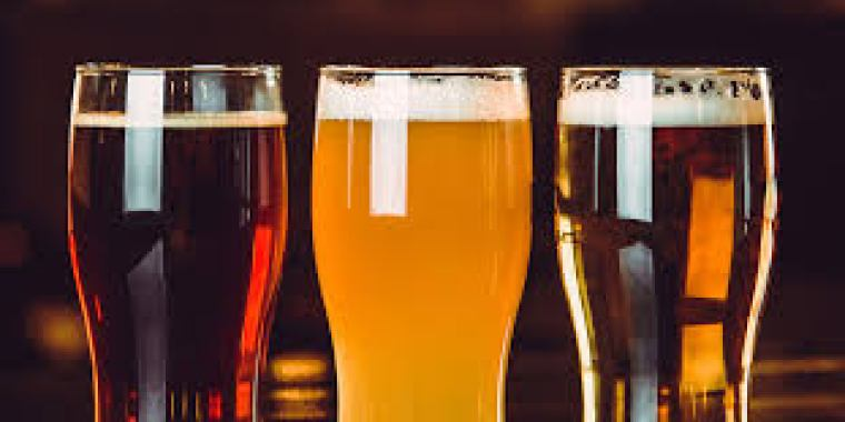 Three glasses of different IPA style beer.
