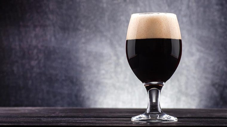 A glass of stout beer.