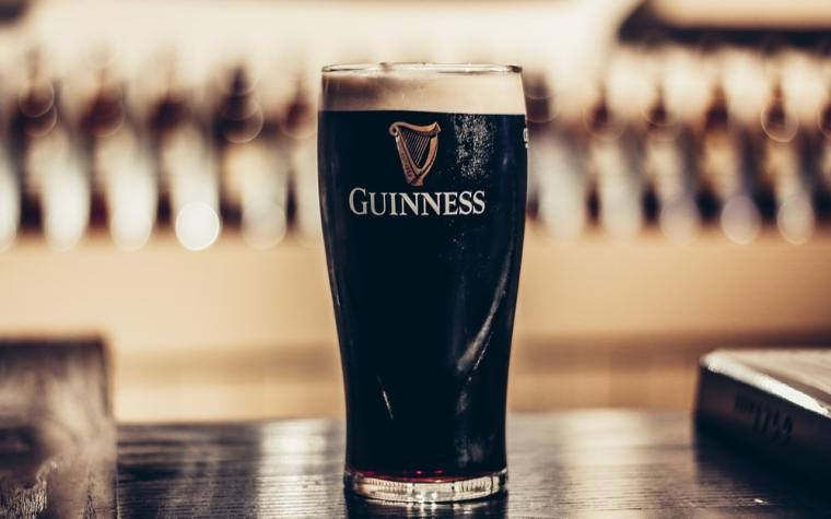 A glass of Guinness Beer Stout.