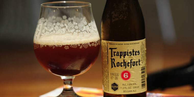 A glass and a bottle of Trappist Single Monk beer.