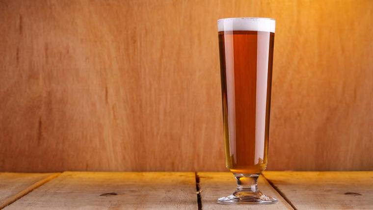 A glass of Vienna style lager beer.