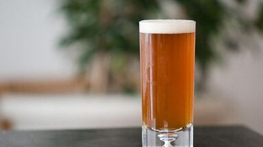 A glass of amber American Pale Ale beer