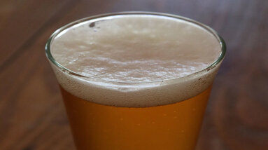 A glass of light beer.