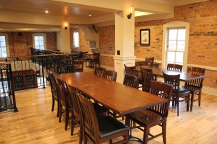 mezzanine view of long tables for hosting parties