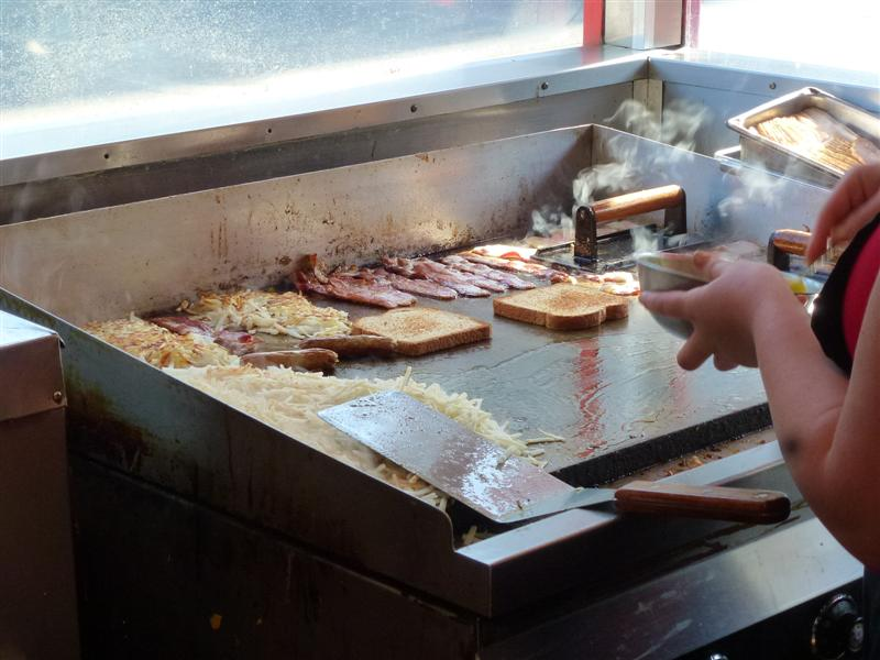 A view of breakfast on the griddle at Sacramento's Jim-Denny's