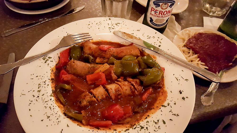 A plate of italian sausage in sauce at Saputo's Italian Restaurant.