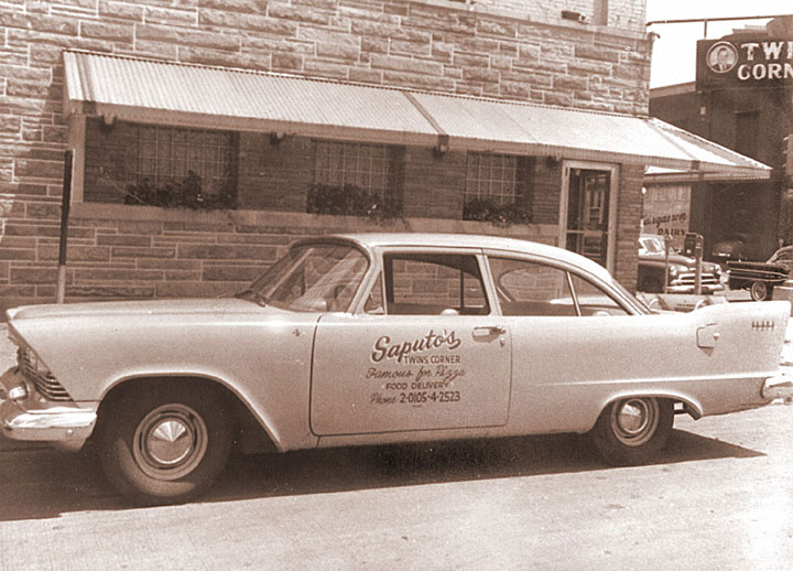A picture of an old car used for Saputo's food deliveries.