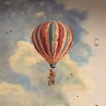 FIcklewood's mural showing a floating hot air balloon.