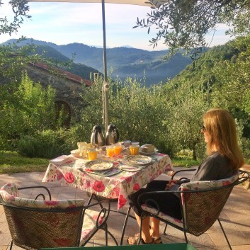 Denise enjoying breakfast on the terrace at Il Gallo, Lucca, Italy
