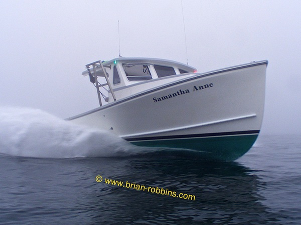 Matt Donnell's Samantha Anne, a Duffy 35 finished by Dana's Boat Shop of Westport Island, ME - shot in the fog outside the mouth of York River.