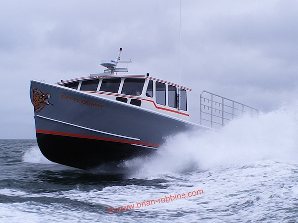 Rattlesnake is an Osmond 47 owned by lobsterman Derek Feeney of Cutler, ME. Rattlesnake's hull and top were built by H&H Marine of Steuben; the 47-footer was custom finished by Feeney Boat Shop in Cutler. (2015)