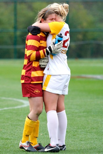 Senior goalkeeper Maddie Jobe embraces her teammate after playing her final game for the Cyclones. Iowa State lost to Baylor 1-0 in their Big 12 Championship tournament game at the Swope Soccer Village on Nov. 6.