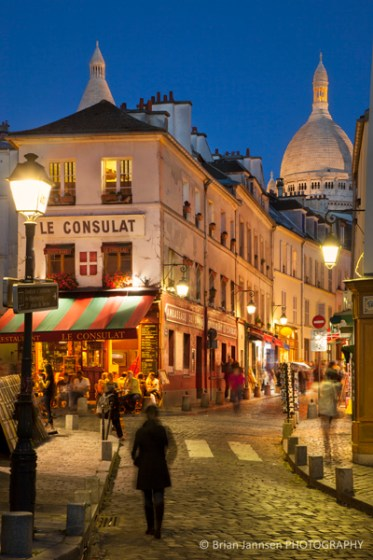 Twilight in the cobblestone streets of Monmartre with Tower of Basilique du Sacre Coeur beyond, Paris France