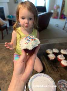 Child Looking at Cupcake With Sprinkles