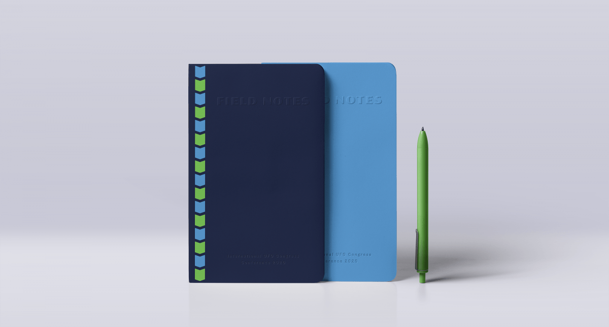 two field notes notebooks with a green pen