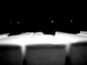 Black and white old school piano closeup disposable camera