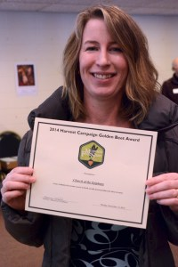 Holly Guncheon, one of the original promoters of creating a Giving Garden at Epiphany, proudly shows off the Golden Beet Award.