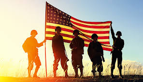 soldiers holding up american flag