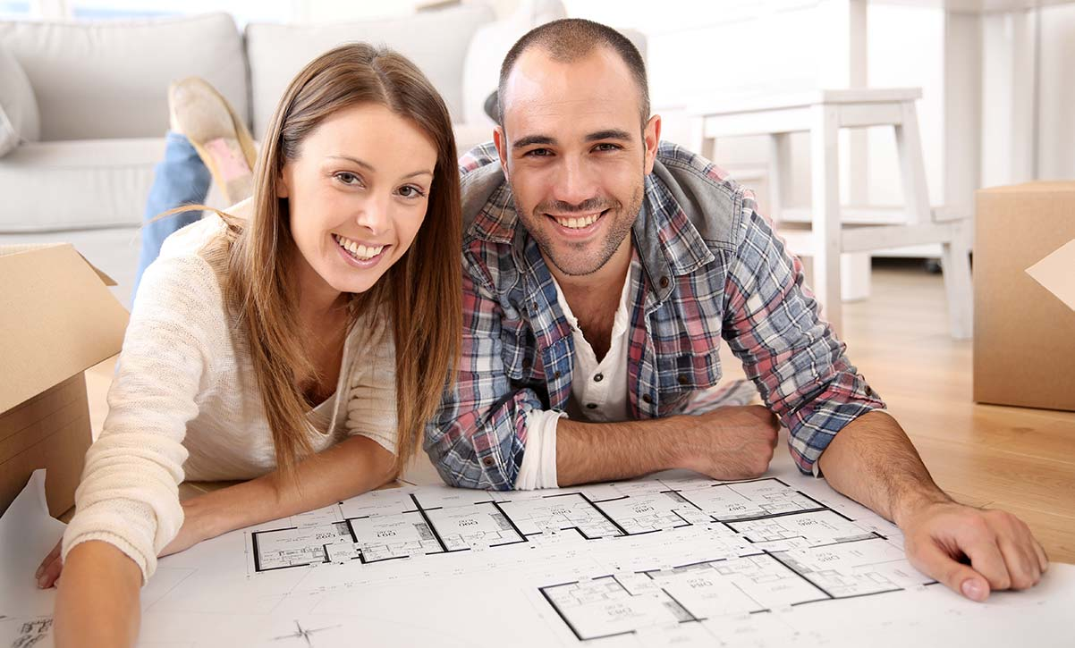 Young Couple Looking at Construction Documents