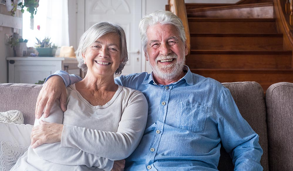 A happy elderly couple that qualified for a Home Equity Conversion Mortgage.