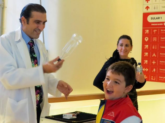 Magician in Malta performing science magic show for opening of Esplora in Malta