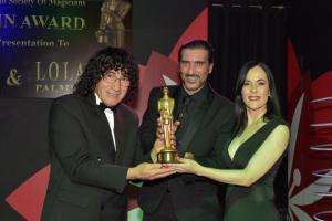 Brian Role` and Lola Palmer awarded with a 'Merlin Award', the 'Oscar' for magic!