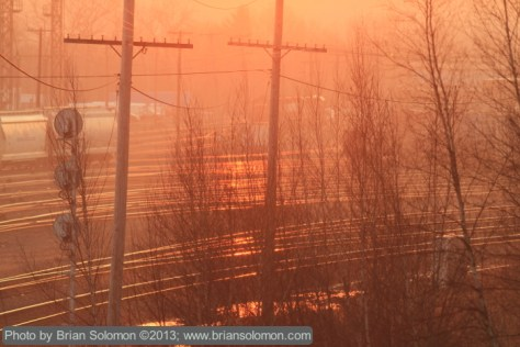 Looking toward the rising sun at East Deerfield Yard. Canon 7D fitted with an f2.8 200mm lens; ISO 200, f3.5 1/500th second.