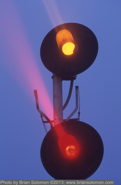 Searchlight signal at Brookfield, Wisconsin exposed with a Nikon F3T with f1.8 105mm lens on Fuji Provia 100 film.