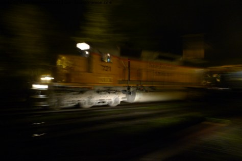 New England Central freight arrives at Palmer yard. Lumix LX3 ISO 200 set at f2.6 1.6 seconds, panned hand held in the rain.