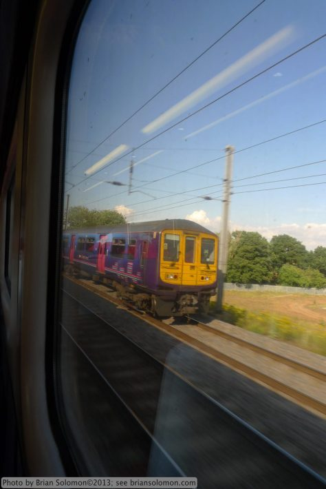 View from a London bound HST overtaking a First Capitol Connect suburban electric train south of Bedford. The old Midland Railway four track mainline is among the busiest long distance routes in Britain.
