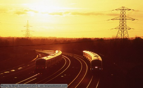 Sunset of trains passing.