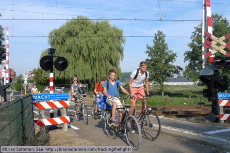 Bicycles at a Dutch level crossing.