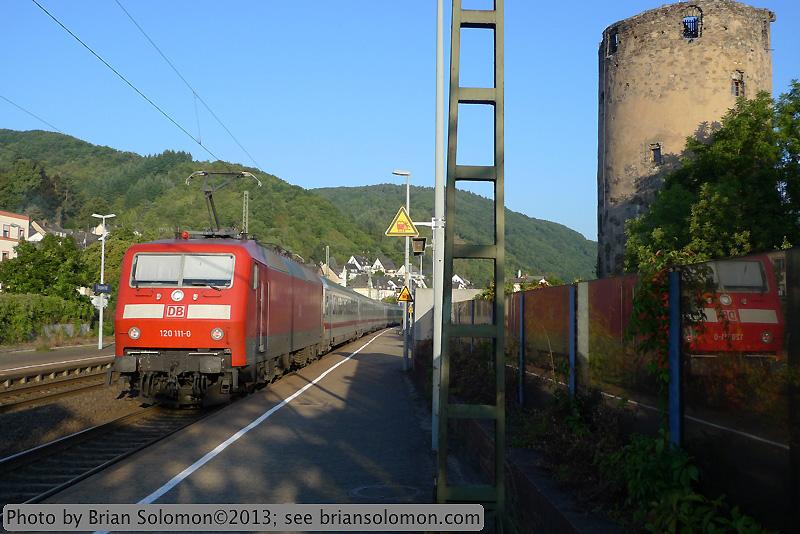 German passenger train with castle.