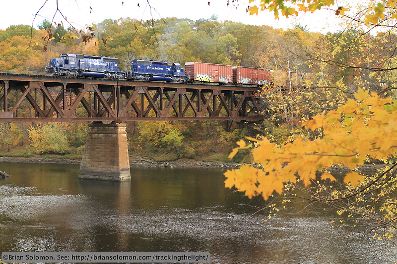 Freight train crossing river.