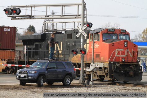 CN's Q11651-04 at Waukesha at 10:50 am on November 8, 2013. I exposed this photo using my Canon EOS 7D with 100mm lens. To gain a bit of elevation, I stood on Chris Guss's Toyota Front Runner that is specially equipped with a roof rack for photography.