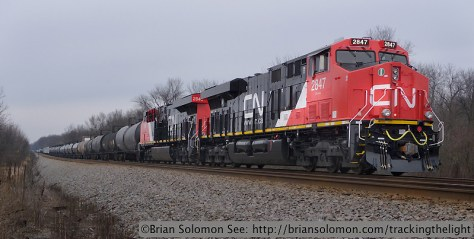 New CN General Electric diesels with M34241-07 with a freight some 9,300 feet long (weighing an estimated 17,000 tons). Another new GE was cut-in mid-train working as a radio controlled 'distributed power unit.' This train is holding at Marsh siding for a northward train. Lumix LX3 photo.
