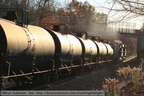 CSX's empty ethanol train catches the glint of the setting sun at Brookfield, Massachusetts. Exposed with a Canon EOS 7D with 100mm lens at f8 1/500th of a second ISO 200, daylight white balance.