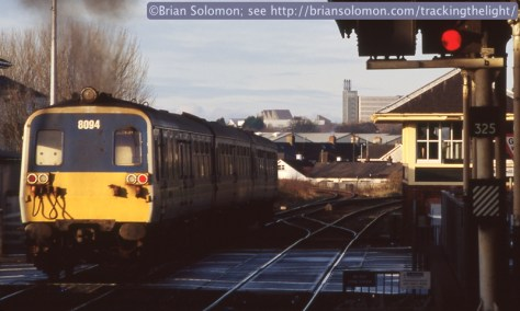 With a puff of exhaust, an 80-class railcar accelerates away from Coleraine station.