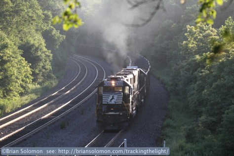 Morning glint illuminates the helpers at the back of coal train. Canon EOS 7D with 28-135mm lens, set at 120mm and at f5.0 1/500, ISO 400.