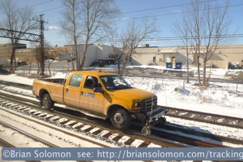 Metro North Railroad HyRail truck as viewed from Amtrak 56 on the afternoon of January 23, 2014. Lumix LX3 photo.