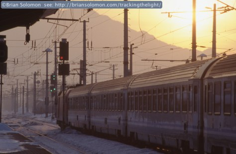 A Westward EuroCity train with Italian carriages accelerates away from Wörgl, Austria on February 1, 2006. Exposed on Fuji 400F slide film using a Canon EOS 3 fitted with 75-300 image stabilizing zoom lens.