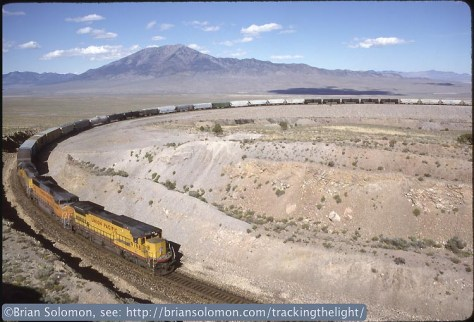 Union Pacific westward freight at the Arnold Loop, July 26, 1993. Exposed on Kodachrome 25 using a Nikon F3T with 28mm lens.