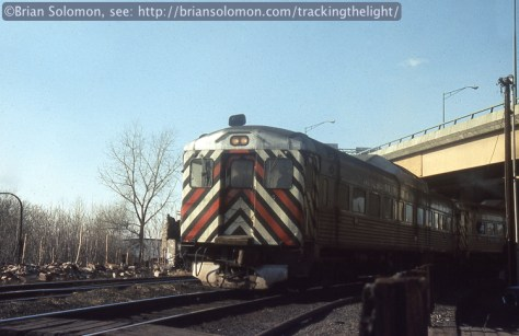Amtrak RDC's depart Springfield, Massachusetts in Spring 1974. Nearby were a pair of bright yellow railroad snow plows.